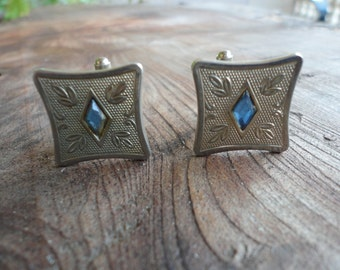 Silver Tone Cuff Links With Center Blue Stone