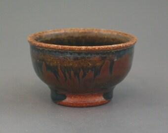 Teacup, woodfired iron-rich stoneware w/ tenmoku, nuka and natural ash glazes