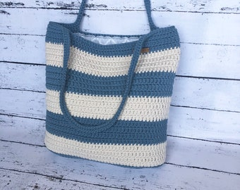 Crochet blue and cream tote bag, lined, striped, with pocket.