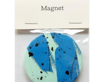 "Magnet by Fiona Hamilton - One Off, Paint, Pattern, Splash, Splodge, Foil, 2.25"", Blue, Turquoise, Black"
