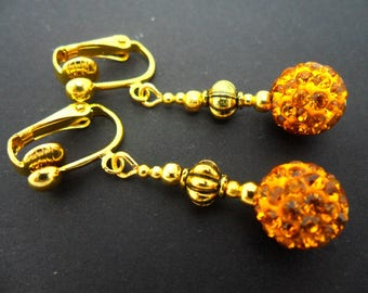 A pair of pretty gold colour shamballa style dangly clip on earrings.