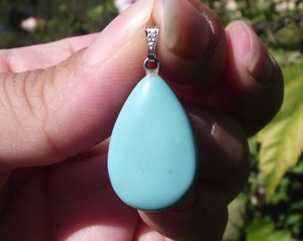 1 PENDANT BEAD TURQUOISE WITH 24 X 17 X 6 MM RING.