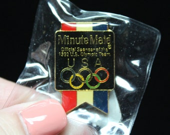 1992 Olympic Pin Minute Maid Advertising, Metal pin and butterfly holder, Colorful Rings, Red White and Blue Banner, Gold Tone Metal