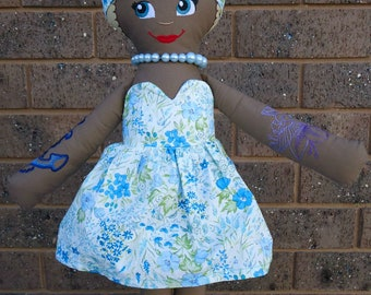 Tattooed Pin Up Doll with Pale Blue Floral Dress and Do-Rag