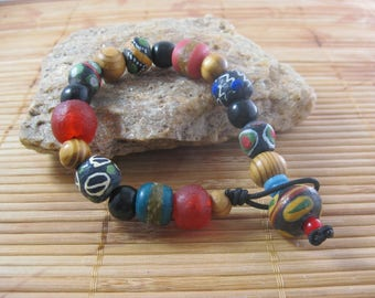 Multi-colored African Trade bead bracelet with King bead, olive wood beads, recycled glass beads, black wood beads