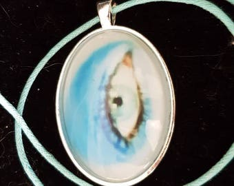 David Bowie Eye pendant necklace on waxed cord.