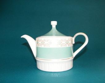 Porcelain teapot in green and gold tones. German porcelain Kahla Volkstedt factory marks.