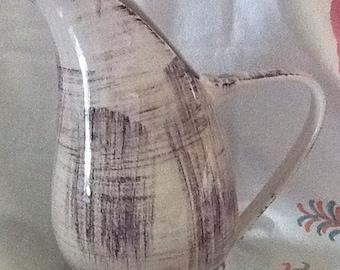 "Vernon Kilns ""Barkwood"" pattern pitcher. Very retro looking."