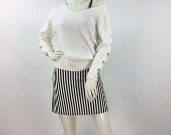 1980s vintage pull over knit sweater, criss cross knit arms, ivory 80s sweater
