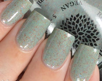 Green-Tinted Grey Crelly with Rainbow Flakies Nail Polish by Black Dahlia Lacquer - Rose Bud