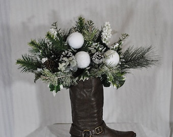 winter arrangement in a cowboy boot, green and white floral arrangement, country floral arrangement, Christmas cowboy boot arrangement