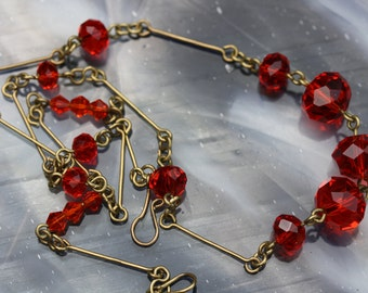 Lovely and feminine, vintage faceted red glass necklace.