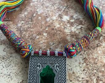 Oxidized Green pendant with multi-colored thread