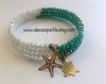 White and Teal Memory Bracelet with Starfish & Turtle Charmss/ Pulsera Memoria Blanca y Verde Azulado con dijes Estrella de Mar y Tortuga