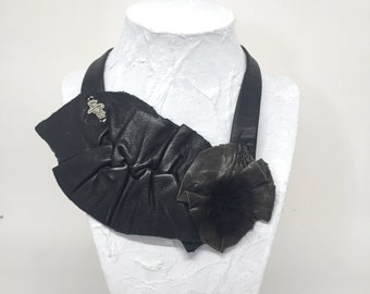 Black leather necklace and tassel of rabbit recyle