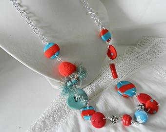 Long necklace in red and blue fabrics, ceramic beads, wood, raffia and glass