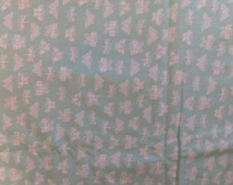 White Butterflies on Mint Green Fabric by the yard