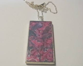 Handcrafted  polymer clay pendant in pink and purple in silver tray with silver snake chain