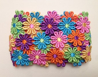 Macrame ' polyester ribbon with coloured flowers 25 mm