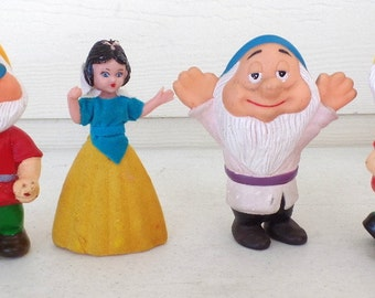 Set of 4- vintage dwarfs, and Snow White figures.  They are flocked, and date to the 1950-60s.
