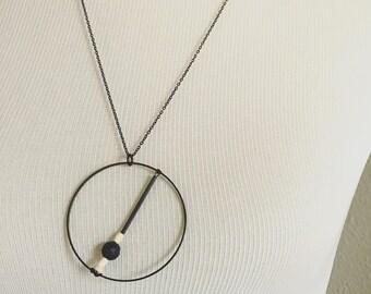 Geometric black lava stone diffuser necklace