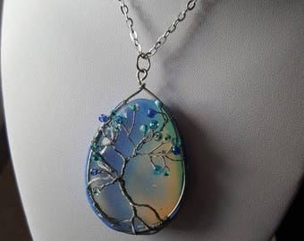 A tree necklace with opalite, wire and polymer clay