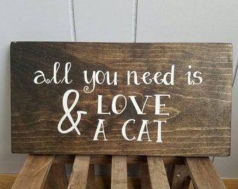 All you need is love and a cat wood wall art