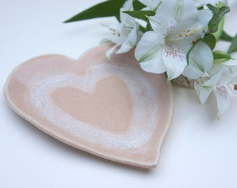 Handmade ceramic heart dish, small hand formed heart shaped plate for modern home decor, unique orange & white jewellery or trinket dish