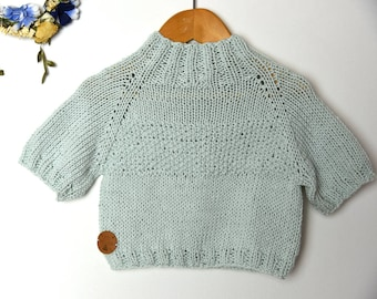 light blue turtleneck sweater, cotton