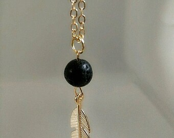 Feather charm necklace with lava bead