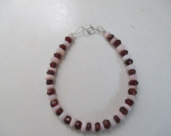 A Garnet and pink opal bracelet with sterling silver findings.