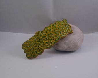 hair clip polymer clay in shades of yellow and blue/green