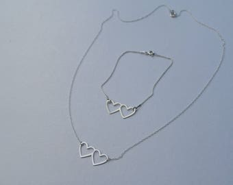 Floating double heart friendship bracelet and pendant set. Solid 925 sterling silver throughout.