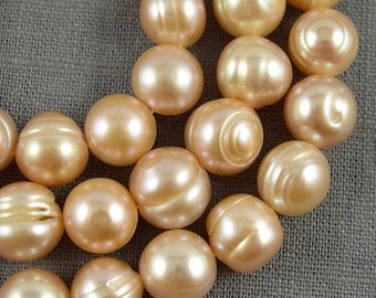 wholesale Potato pearl necklace 9.5-10.5mm Large hole Freshwater pearl Round pearl loose pearls Potato pearl Peach 40Pcs Full Strand PL2085