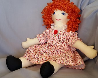 15 inch cloth (rag) doll, with hair and eye color of your choice, comes dressed in a white cotton dress with floral design and white panties