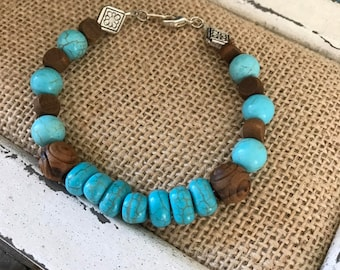 """turquoise and brown wood beaded bracelet   8 1/2"""""""