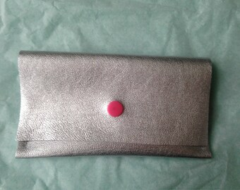 Silver leather clutch, pink clasp