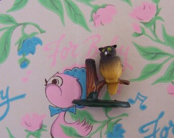 tiny rubbery owl on a branch