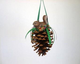 Ornament, pine cone ornament, decorated pine cone with ceramic squirrel