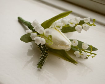 Spring buttonhole/boutonniere. Designed with an artificial ivory tulip, heather and lily of the valley.