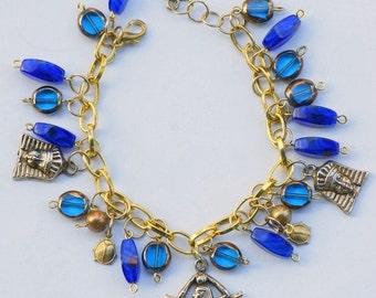 Walk Like an Egyptian, Isis, Pharaoh, Blue, Gold Tone Charm Bracelet