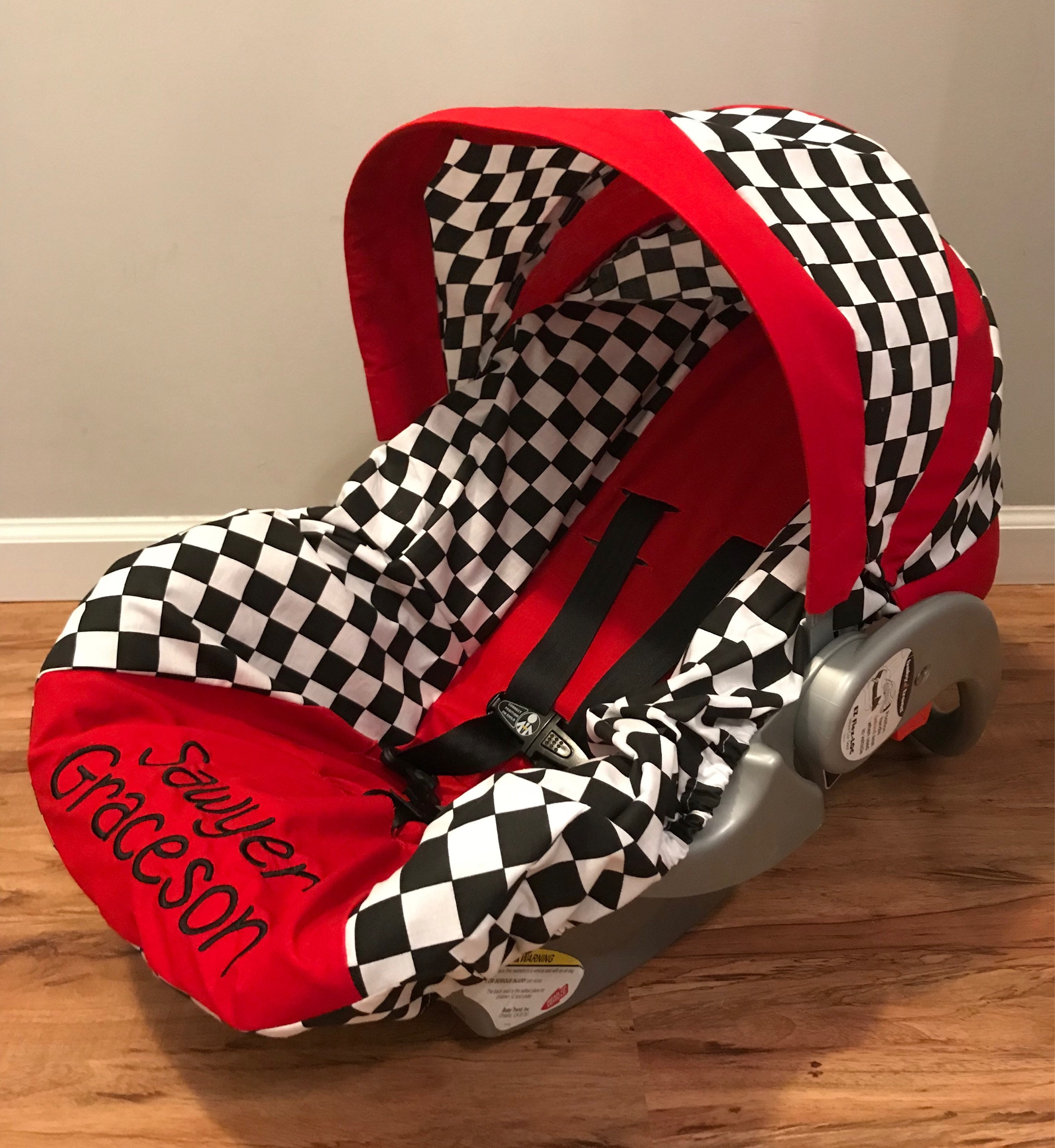checkered flag black and white squares red infant car seat. Black Bedroom Furniture Sets. Home Design Ideas