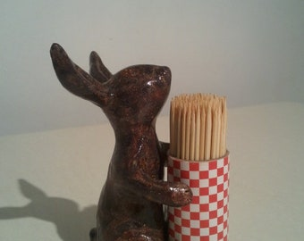 Standing rabbit wearing spikes