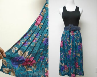 "ELECTRIC YOUTH . electric pleats floral skirt . size 12. waist 25.5"" - 35"""