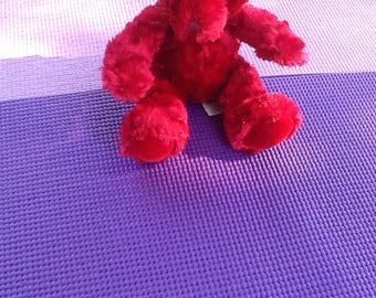 Red Plush Bear for Christmas. 9 inches tall. Velvety Plush with Bow. Shown singlely and Seated or climbing poses. Bright & Cheerfully Teddy.