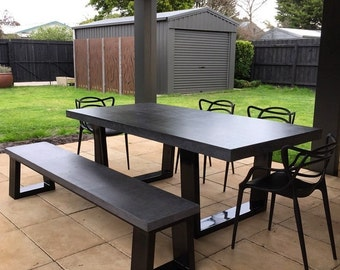 Polished concrete dining table and bench seat patio alfresco table with powder coated black base & Polished concrete 8 to 10 seater dining table with 4 powder