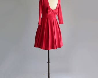 DECEMBER | Red - true poppy red dress with long sleeves. vintage inspired fit and flare retro dress with back bow + pockets