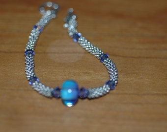 Tons of sterling silver beads with Corina Tettinger focal and swarovski accents