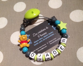 Pacifier lollipop personalized with name winnie the Pooh star anise turquoise dark gray