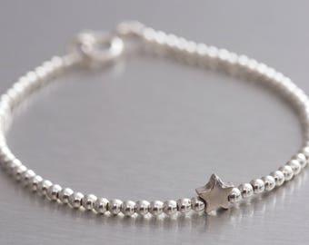Zilveren kralen armband met ster